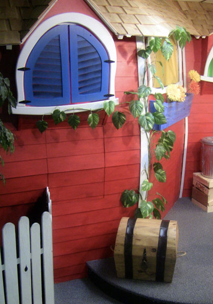 Whimsical house puppet stage